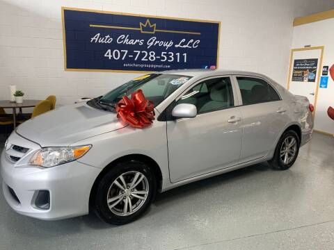 2013 Toyota Corolla for sale at Auto Chars Group LLC in Orlando FL
