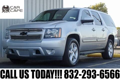 2012 Chevrolet Suburban for sale at CAR CAFE LLC in Houston TX