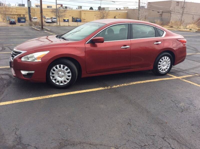 2013 Nissan Altima for sale at AROUND THE WORLD AUTO SALES in Denver CO