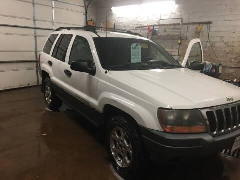 2001 Jeep Grand Cherokee for sale at BARNES AUTO SALES in Mandan ND