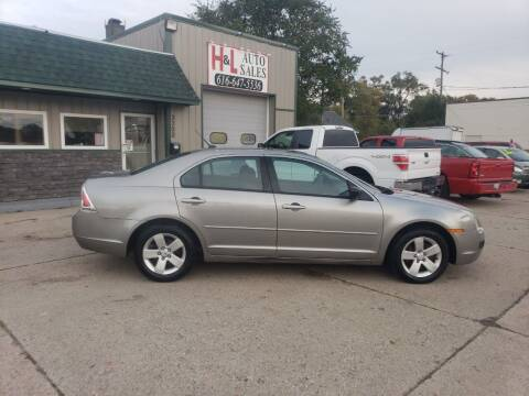 2008 Ford Fusion for sale at H & L AUTO SALES LLC in Wyoming MI