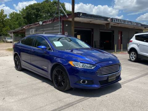2013 Ford Fusion Hybrid for sale at Texas Luxury Auto in Houston TX