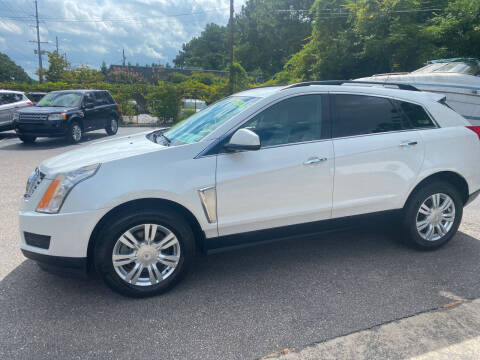 2015 Cadillac SRX for sale at TOP OF THE LINE AUTO SALES in Fayetteville NC