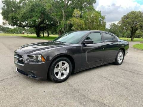 2014 Dodge Charger for sale at ROADHOUSE AUTO SALES INC. in Tampa FL