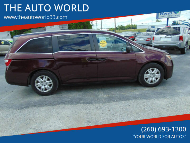 2011 Honda Odyssey for sale at THE AUTO WORLD in Churubusco IN
