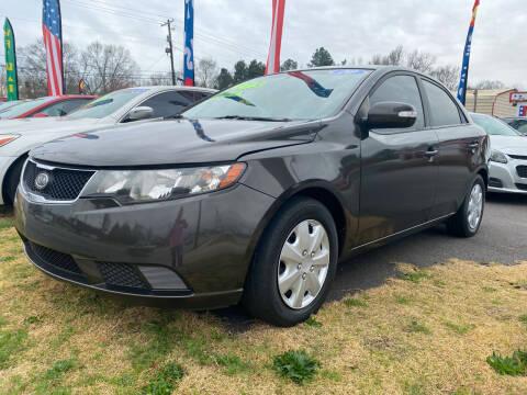 2010 Kia Forte for sale at Cars for Less in Phenix City AL