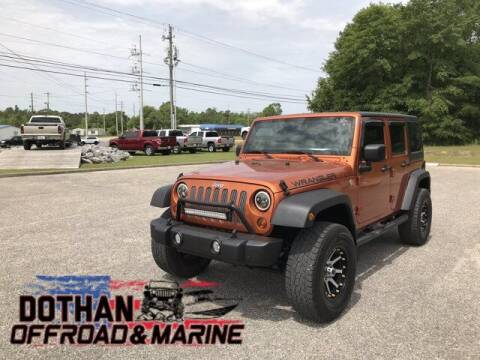 2011 Jeep Wrangler Unlimited for sale at Mike Schmitz Automotive Group in Dothan AL