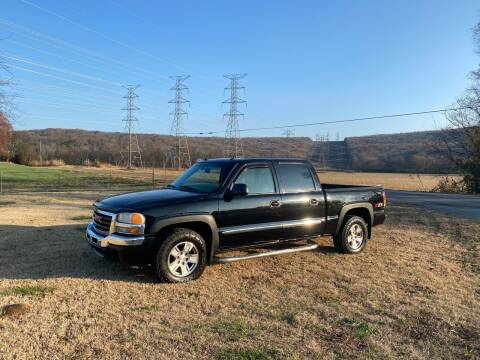2004 GMC Sierra 1500 for sale at Tennessee Valley Wholesale Autos LLC in Huntsville AL