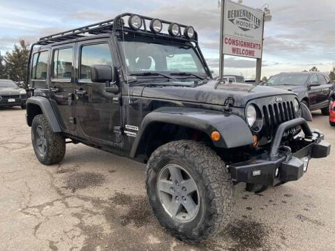 2012 Jeep Wrangler Unlimited for sale at BERKENKOTTER MOTORS in Brighton CO