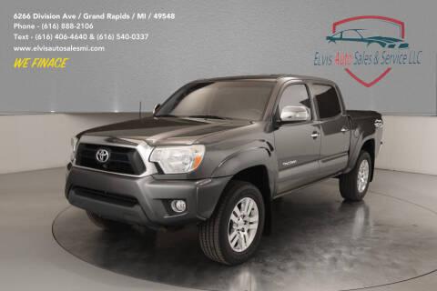 2015 Toyota Tacoma for sale at Elvis Auto Sales LLC in Grand Rapids MI