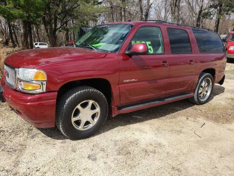 2004 GMC Yukon XL for sale at Northwoods Auto & Truck Sales in Machesney Park IL