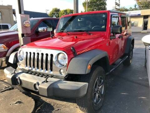 2015 Jeep Wrangler Unlimited for sale at RT Auto Center in Quincy IL