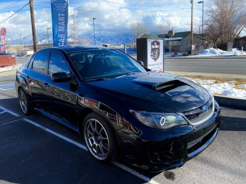2013 Subaru Impreza for sale at The Car-Mart in Murray UT
