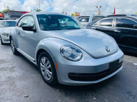 2012 Volkswagen Beetle for sale at America Auto Wholesale Inc in Miami FL