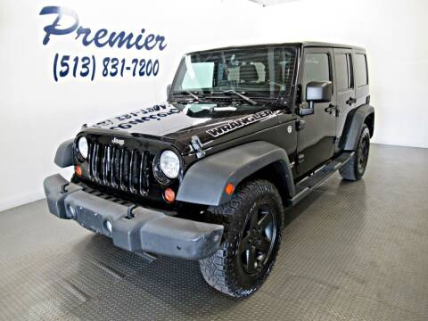 2013 Jeep Wrangler Unlimited for sale at Premier Automotive Group in Milford OH