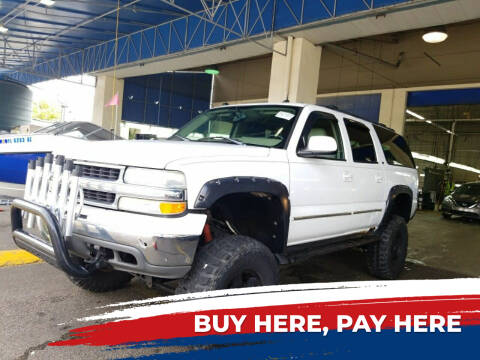 2004 Chevrolet Suburban for sale at L G AUTO SALES in Boynton Beach FL