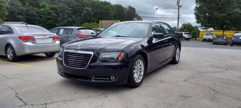 2013 Chrysler 300 for sale at DADA AUTO INC in Monroe NC