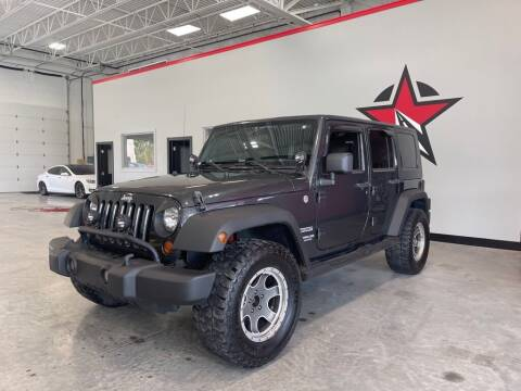 2010 Jeep Wrangler Unlimited for sale at CarNova - Shelby Township in Shelby Township MI