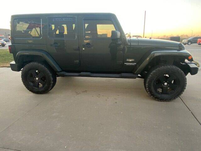 2011 Jeep Wrangler Unlimited for sale at The Ranch Auto Sales in Kansas City MO
