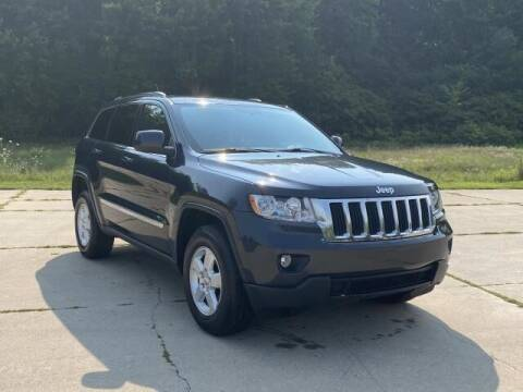 2013 Jeep Grand Cherokee for sale at Betten Baker Preowned Center in Twin Lake MI