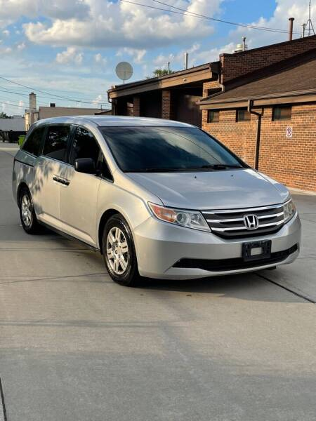 2012 Honda Odyssey for sale at Suburban Auto Sales LLC in Madison Heights MI