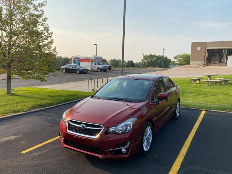 2015 Subaru Impreza for sale at QUEST MOTORS in Englewood CO