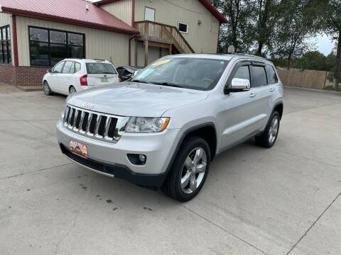 2011 Jeep Grand Cherokee for sale at Azteca Auto Sales LLC in Des Moines IA