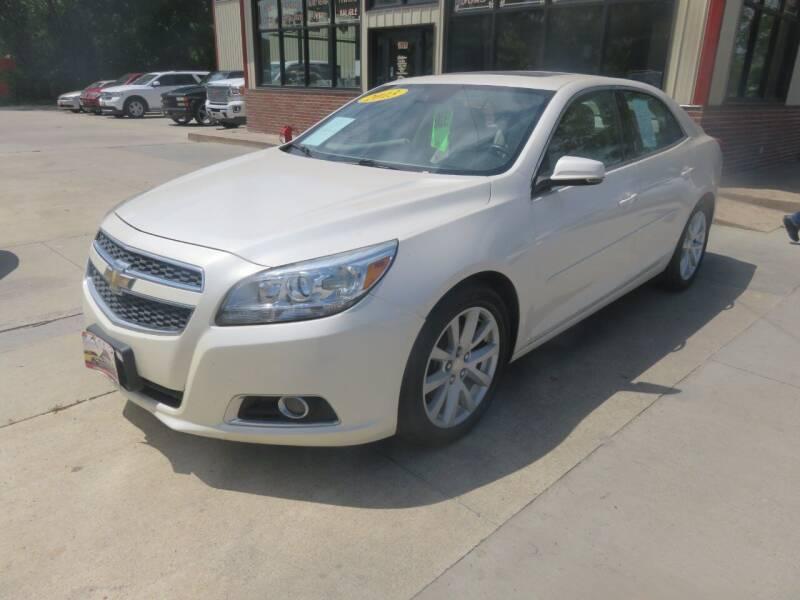 2013 Chevrolet Malibu for sale at Azteca Auto Sales LLC in Des Moines IA