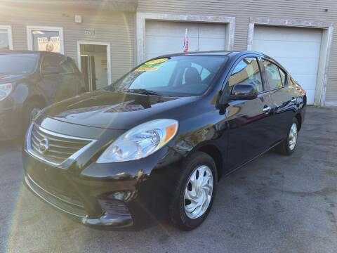 2014 Nissan Versa for sale at Global Auto Finance & Lease INC in Maywood IL
