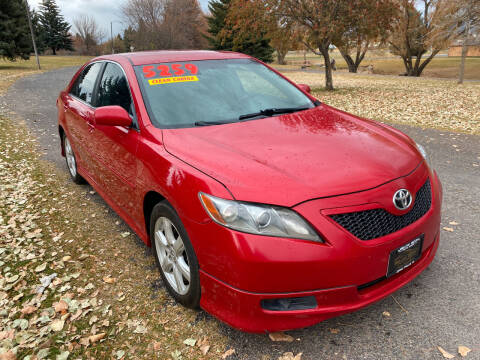 2009 Toyota Camry for sale at BELOW BOOK AUTO SALES in Idaho Falls ID