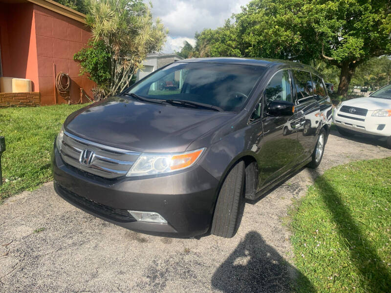 2011 Honda Odyssey for sale at LESS PRICE AUTO BROKER in Hollywood FL