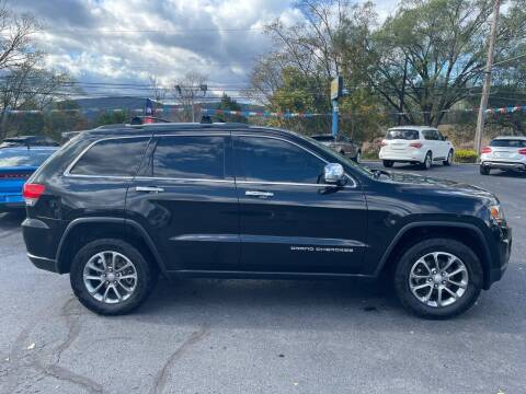 2014 Jeep Grand Cherokee for sale at MAGNUM MOTORS in Reedsville PA