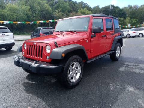 2014 Jeep Wrangler Unlimited for sale at Mulligan's Auto Exchange LLC in Paxinos PA