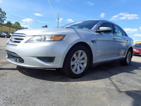 2011 Ford Taurus for sale at RPM AUTO SALES in Lansing MI