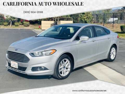 2014 Ford Fusion for sale at CARLIFORNIA AUTO WHOLESALE in San Bernardino CA