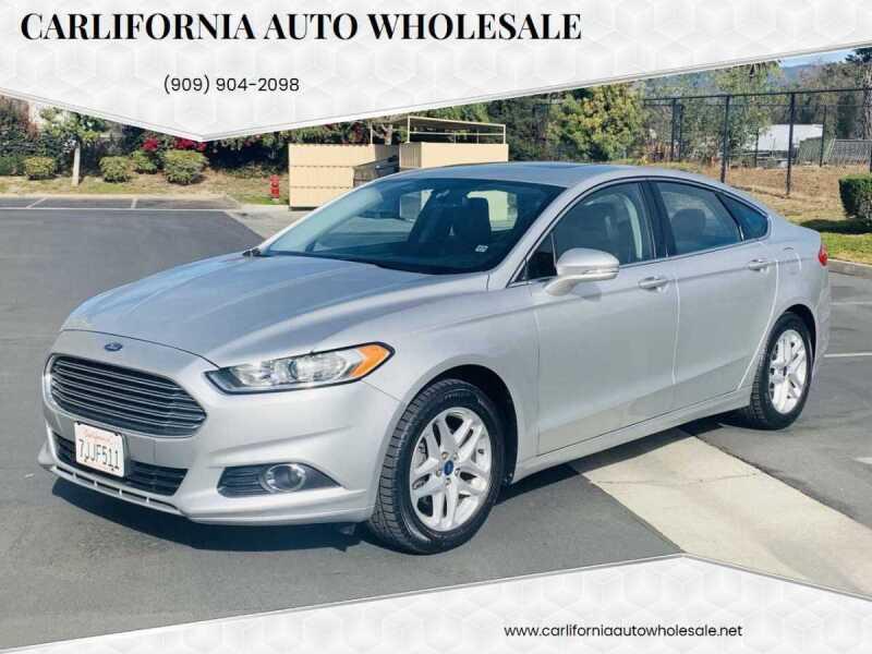 2014 Ford Fusion for sale at CARLIFORNIA AUTO WHOLESALE in San Bernardino CA