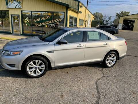 2010 Ford Taurus for sale at RPM AUTO SALES in Lansing MI