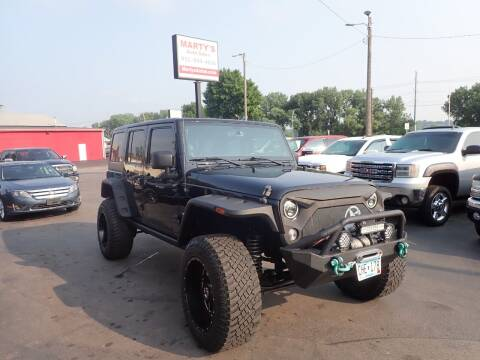 2014 Jeep Wrangler Unlimited for sale at Marty's Auto Sales in Savage MN