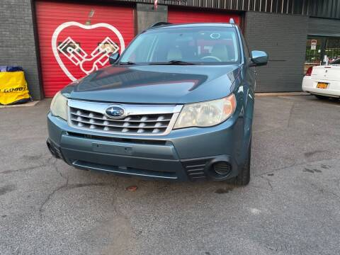 2012 Subaru Forester for sale at Apple Auto Sales Inc in Camillus NY