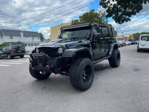 2011 Jeep Wrangler Unlimited for sale at Kapos Auto, Inc. in Ridgewood NY