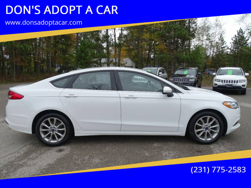2017 Ford Fusion for sale at DON'S ADOPT A CAR in Cadillac MI