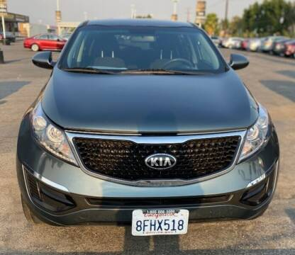2014 Kia Sportage for sale at Global Auto Group in Fontana CA