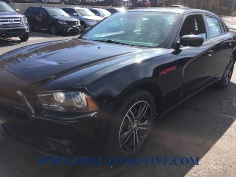 2014 Dodge Charger for sale at J & M Automotive in Naugatuck CT