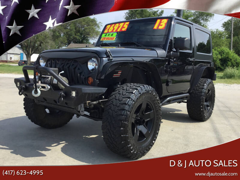 2013 Jeep Wrangler for sale at D & J AUTO SALES in Joplin MO