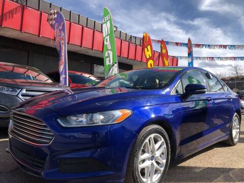 2016 Ford Fusion for sale at Duke City Auto LLC in Gallup NM
