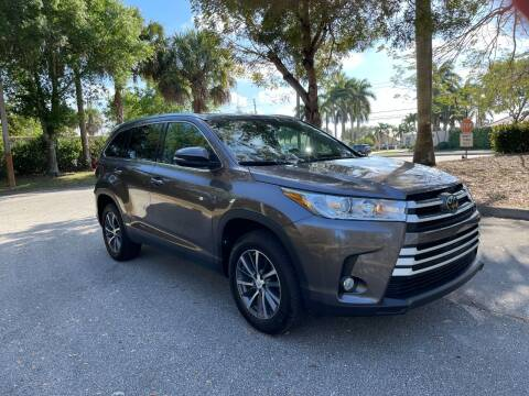 2019 Toyota Highlander for sale at DELRAY AUTO MALL in Delray Beach FL