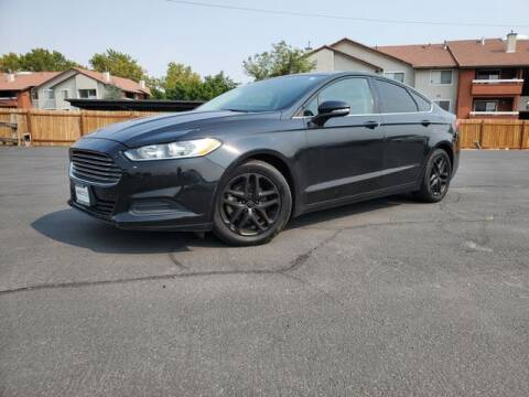 2014 Ford Fusion for sale at INVICTUS MOTOR COMPANY in West Valley City UT
