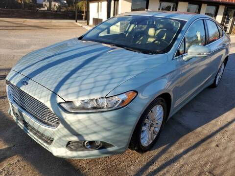 2014 Ford Fusion Hybrid for sale at THE TRAIN AUTO SALES & LEASING in Mauldin SC