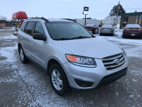 2012 Hyundai Santa Fe for sale at Carney Auto Sales in Austin MN