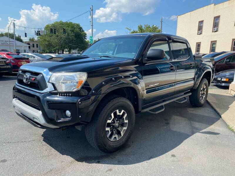 2015 Toyota Tacoma for sale at ADAM AUTO AGENCY in Rensselaer NY